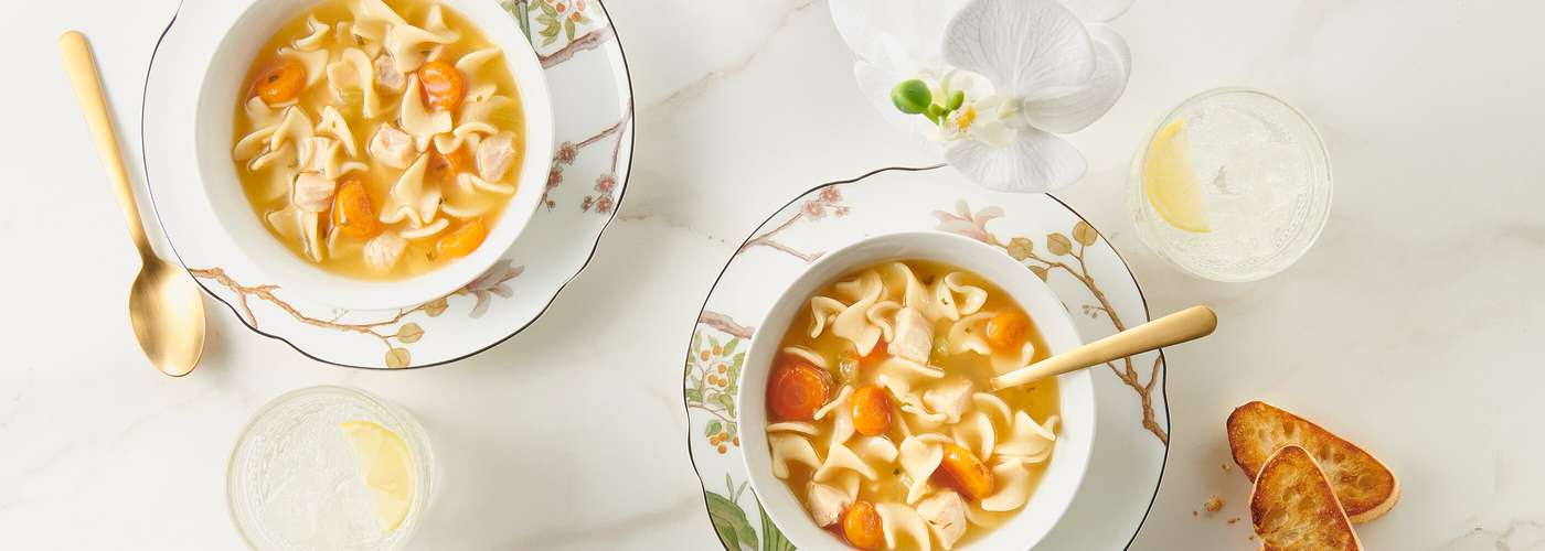 overhead shot of two bowls of Progresso chicken noodle soup